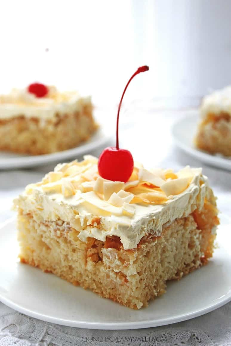 Pina Colada Cake sweet and delicious cake with coconut pineapple and rum Crazy good crunchycreamysweet.com Pina Colada Poke Cake