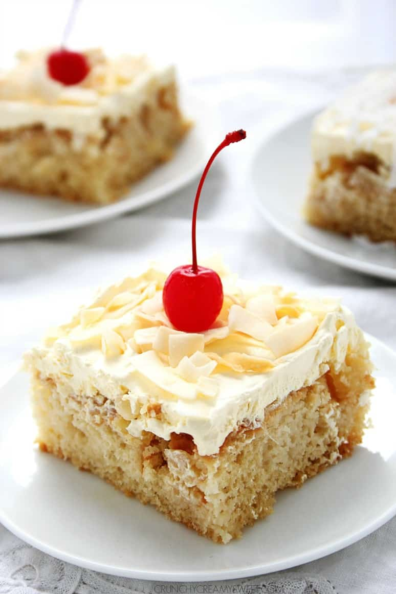 Pina Colada Poke Cake one fantastic cake with all of the flavors of your favorite summer drink crunchycreamysweet.com  Pina Colada Poke Cake