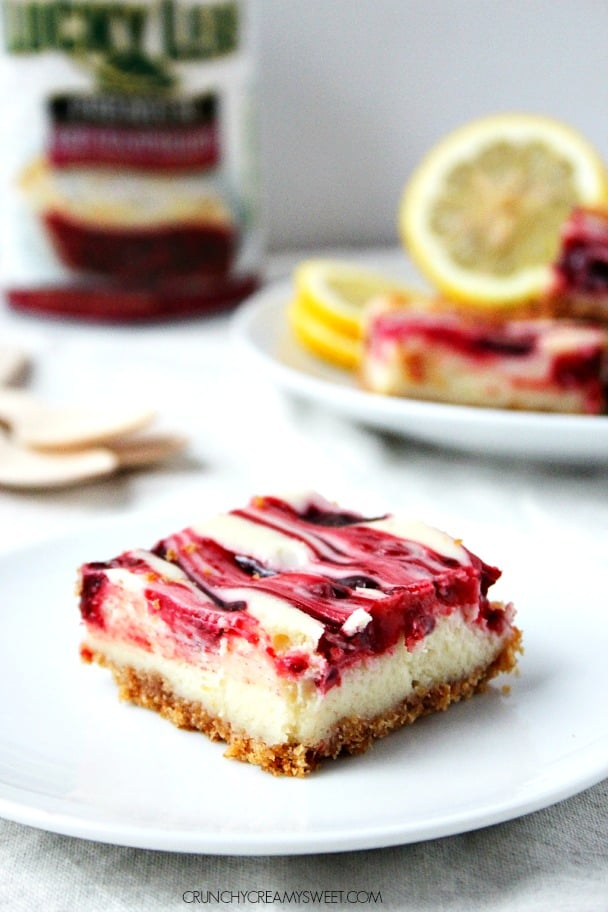 Sweet and creamy lemon raspberry cheesecake bars crunchycreamysweet.com Lemon Raspberry Cheesecake Bars