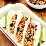 Three chicken tacos in baking dish.