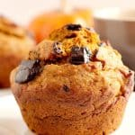 Chocolate Chunk Pumpkin Muffin on a plate.