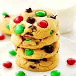 Christmas M&M Cookies stacked on a plate.