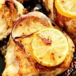 Lemon garlic roasted chicken thighs in cast iron skillet.