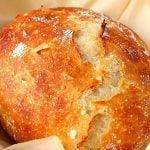 Sourdough bread loaf on parchment paper.