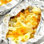 Cheesy Potato Foil Packets open placed on baking sheet.