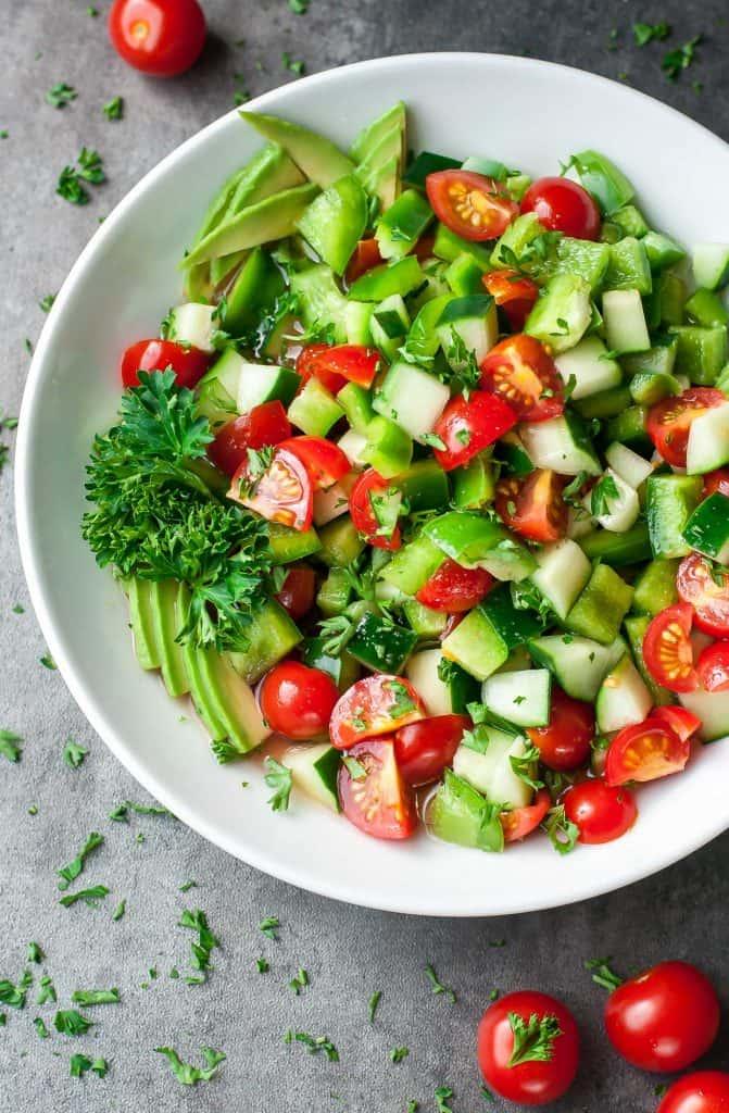 healthy tomato cucumber avocado salad recipe 4756 671x1024 25 Delicious Avocado Recipes