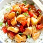 Sweet and Sour Chicken with rice in white bowl.