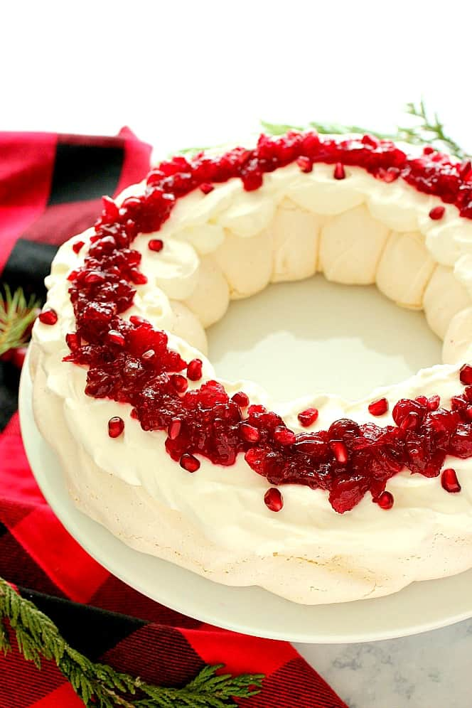 Christmas Pavlova Wreath is a beautiful dessert for the holidays. Christmas Pavlova Recipe