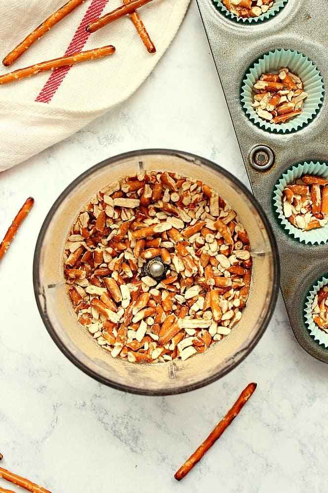 step 1 crush pretzels and line bottoms of cupcake liners. Chocolate Caramel Pretzel Cups Recipe