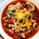Instant Pot chicken tortilla soup in a white bowl.