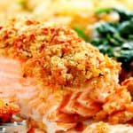 Parmesan Crusted Salmon on plate with spinach and potatoes.