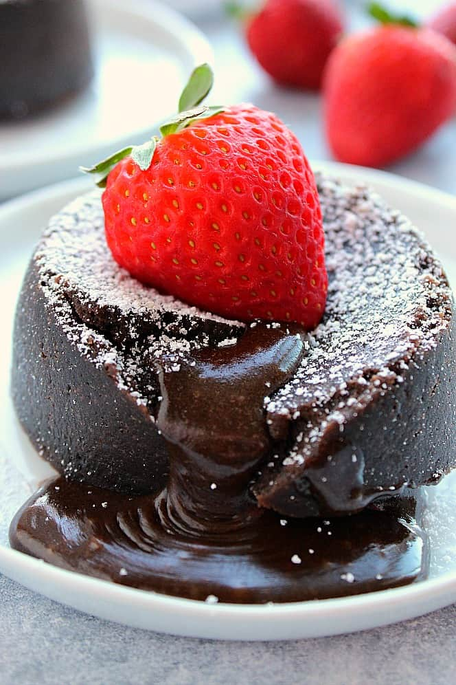 Chocolate lava cake with strawberry on white plate. Instant Pot Chocolate Lava Cake For Two