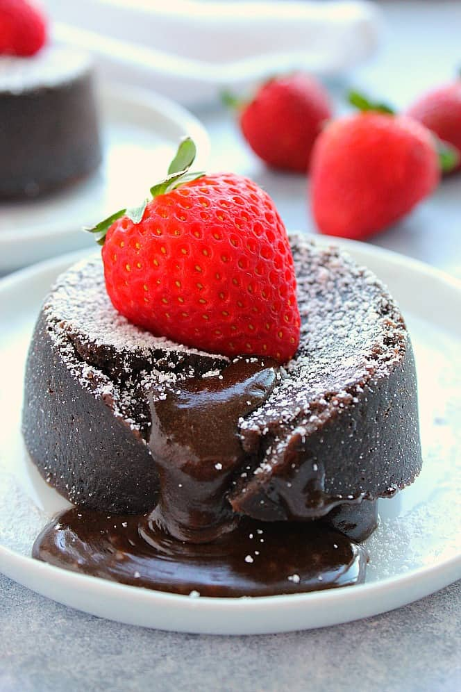 Molten chocolate lava cake with a strawberry on top. Instant Pot Chocolate Lava Cake For Two