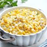 Corn in a creamy sauce in a dish.