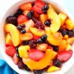 Overhead shot of fruit salad in white bowl.